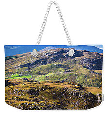 Weekender Tote Bag featuring the photograph Undulating Green, Purple And Yellow Rocky Landscape In  Ireland by Semmick Photo