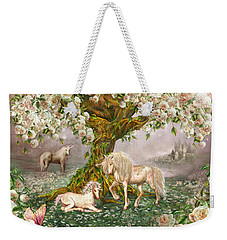 Weekender Tote Bag featuring the mixed media Unicorn Rose Tree by Carol Cavalaris