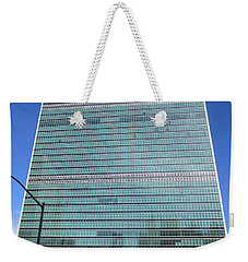 Weekender Tote Bag featuring the photograph United Nations 3 by Randall Weidner