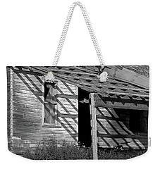 Weekender Tote Bag featuring the photograph Unprotective Persistence by Christopher McKenzie