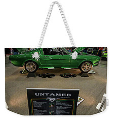 Weekender Tote Bag featuring the photograph Untamed by Randy Scherkenbach