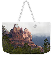 Weekender Tote Bag featuring the photograph Veiled In Clouds by Phyllis Denton
