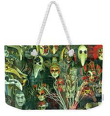 Weekender Tote Bag featuring the photograph Venetian Masks by Anne Kotan