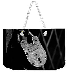 Weekender Tote Bag featuring the photograph Very Secure by Doug Camara