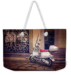Weekender Tote Bag featuring the photograph Vespa Scooter In Milan Italy  by Carol Japp