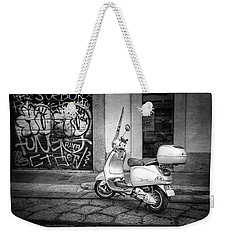 Weekender Tote Bag featuring the photograph Vespa Scooter In Milan Italy In Black And White  by Carol Japp