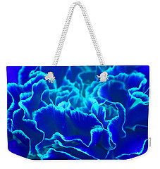 Weekender Tote Bag featuring the photograph Vibrant Blue And Turquoise Carnation Flower by Shelley Neff