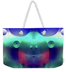 Weekender Tote Bag featuring the photograph Vibrant Symmetry Oil Droplets by John Williams