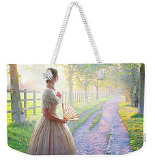 Victorian Woman On A Rural Path At Sunset Weekender Tote Bag by Lee Avison