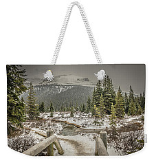 Weekender Tote Bag featuring the photograph View From The Bridge by Bill Howard