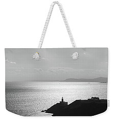 Weekender Tote Bag featuring the photograph View Of Howth Head With The Baily Lighthouse In Black And White by Semmick Photo