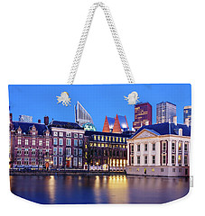 Weekender Tote Bag featuring the photograph View Of Mauritshuis And The Hofvijver - The Hague by Barry O Carroll