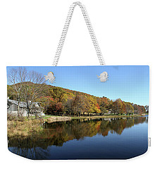 Weekender Tote Bag featuring the photograph View Of Peaks Of Otter Lodge And Abbott Lake  In Autumn by Emanuel Tanjala