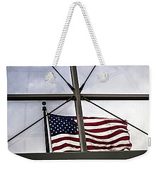 View Of The American Flag Through The Glass Dome Of The Overture Center Weekender Tote Bag