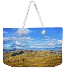 Weekender Tote Bag featuring the photograph View Of The Mountains And Valleys In Ballycullane In Kerry Irela by Semmick Photo