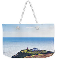 Weekender Tote Bag featuring the photograph View Of The Trails On Howth Cliffs With The Lighthouse In Irelan by Semmick Photo