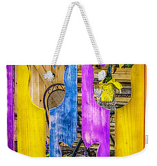 Weekender Tote Bag featuring the photograph View Thru The Fence by Nick Zelinsky