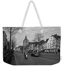Weekender Tote Bag featuring the photograph View To The Bosch Street In Maastricht by Nop Briex