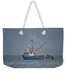 Weekender Tote Bag featuring the photograph Viking Fisher 4 by Randy Hall