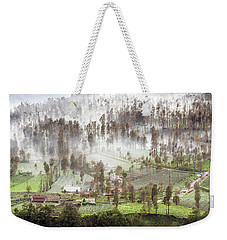 Weekender Tote Bag featuring the photograph Village Covered With Mist by Pradeep Raja Prints