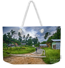 Weekender Tote Bag featuring the photograph Village Scene by Charuhas Images