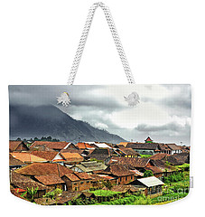 Weekender Tote Bag featuring the photograph Village View by Charuhas Images