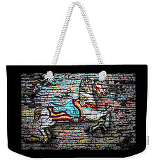 Weekender Tote Bag featuring the photograph Vintage Carousel Horse by Michael Arend