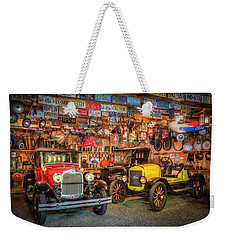 Weekender Tote Bag featuring the photograph Vintage Fords Collectibles by Debra and Dave Vanderlaan