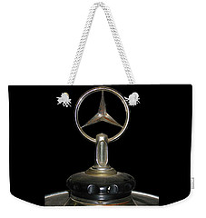 Weekender Tote Bag featuring the photograph Vintage Mercedes Radiator Cap by David and Carol Kelly