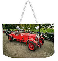 Weekender Tote Bag featuring the photograph Vintage Motors by Adrian Evans