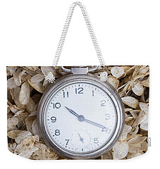 Weekender Tote Bag featuring the photograph Vintage Pocket Watch Over Dried Flowers by Edward Fielding