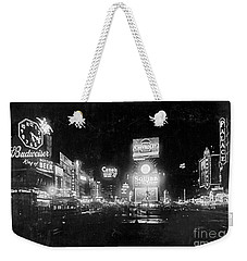 Weekender Tote Bag featuring the photograph Vintage Times Square At Night Black And White by John Stephens