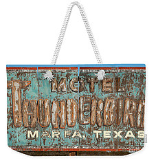 Weekender Tote Bag featuring the photograph Vintage Weathered Thunderbird Motel Sign Marfa Texas by John Stephens