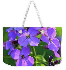 Weekender Tote Bag featuring the photograph Purple Flower by Melinda Blackman