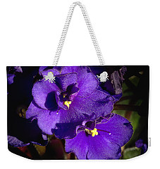 Weekender Tote Bag featuring the photograph Violets by Phyllis Denton