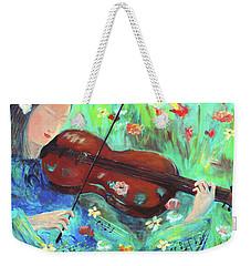 Violinist In Garden Weekender Tote Bag by Haleh Mahbod