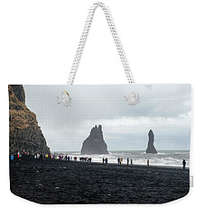 Weekender Tote Bag featuring the photograph Visitors In Reynisfjara Black Sand Beach, Iceland by Dubi Roman