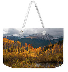 Weekender Tote Bag featuring the photograph Vivid Autumn Aspen And Mountain Landscape by Cascade Colors