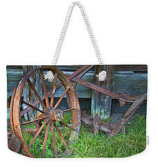 Weekender Tote Bag featuring the photograph Wagon Wheel And Fence by David and Carol Kelly