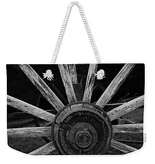 Weekender Tote Bag featuring the photograph Wagon Wheel by Eric Liller