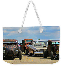 Weekender Tote Bag featuring the photograph Waiting In Line by Christopher McKenzie