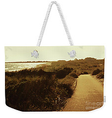 Weekender Tote Bag featuring the photograph Walk Along The Beach by Cassandra Buckley