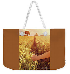 Weekender Tote Bag featuring the photograph Walking Through Wheat Field by Lyn Randle