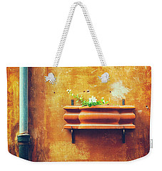 Weekender Tote Bag featuring the photograph Wall Gutter Vase by Silvia Ganora