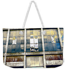Weekender Tote Bag featuring the photograph Warehouse Wall by Wayne Sherriff