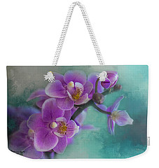 Weekender Tote Bag featuring the photograph Warms The Heart by Marvin Spates