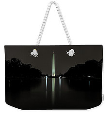 Weekender Tote Bag featuring the photograph Washington Monument At Night by Ed Clark