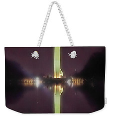 Weekender Tote Bag featuring the photograph Washington Monument by Lorella Schoales