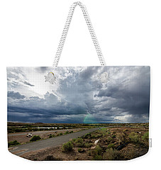 Weekender Tote Bag featuring the photograph Watching The Storms Roll By by Margaret Pitcher