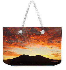 Weekender Tote Bag featuring the photograph Water And Fire by Andrew Drozdowicz